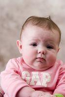 Tegn og symptomer på magevirus i babyer