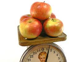 Hva er forskjellen mellom en Vekt Scale & et Balanced Scale?