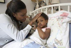 Tegn og symptomer på Magen influensa hos spedbarn