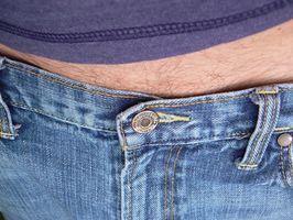 Hva er årsaken til hårvekst på mage?