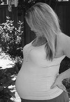 Hva er årsakene til tidlig Abdominal & Back Pain tidlig i svangerskapet?
