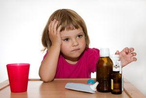 Hvilke forholdsregler bør jeg ta når jeg tar en barnets temperatur?