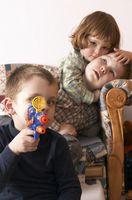 Hva er tegn og symptomer på parasitter hos barn?