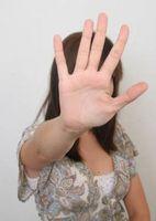 skjelvende hender symptom