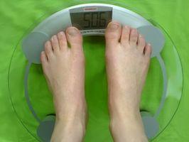 Hvordan endrer jeg fra kg til Lbs på en helse O Meter Touch?